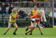 17 June 2018; Lauren McConville of Armagh in action against Treasa Doherty, left, and Nicole McLaughlin of Donegal during the TG4 Ulster Ladies Football Senior Championship Final match between Armagh and Donegal at Brewster Park in Enniskillen, Co. Fermanagh. Photo by Daire Brennan/Sportsfile