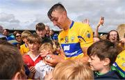 17 June 2018; Peter Duggan of Clare is surrounded by autograph hunters after the Munster GAA Hurling Senior Championship Round 5 match between Clare and Limerick at Cusack Park in Ennis, Clare. Photo by Ray McManus/Sportsfile