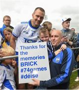 17 June 2018; Michael Walsh of Waterford has his photograph taken with Beth Ryan, age 5, and her father Derek, from Waterford, after the Munster GAA Hurling Senior Championship Round 5 match between Waterford and Cork at Semple Stadium in Thurles, Tipperary. Photo by Matt Browne/Sportsfile
