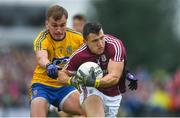 17 June 2018; Damien Comer of Galway in action against Enda Smith of Roscommon during the Connacht GAA Football Senior Championship Final match between Roscommon and Galway at Dr Hyde Park in Roscommon. Photo by Ramsey Cardy/Sportsfile