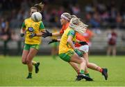 17 June 2018; Lauren McConville of Armagh in action against Treasa Doherty of Donegal during the TG4 Ulster Ladies Football Senior Championship Final match between Armagh and Donegal at Brewster Park in Enniskillen, Co. Fermanagh. Photo by Daire Brennan/Sportsfile