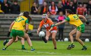 17 June 2018; Lauren McConville of Armagh in action against Emer Gallagher, left, and Therese McCaffrey of Donegal during the TG4 Ulster Ladies Football Senior Championship Final match between Armagh and Donegal at Brewster Park in Enniskillen, Co. Fermanagh. Photo by Daire Brennan/Sportsfile
