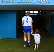 17 June 2018; Michael Walsh of Waterford makes his way to the dressing room with his son Tadhg, age 2, after the Munster GAA Hurling Senior Championship Round 5 match between Waterford and Cork at Semple Stadium in Thurles, Tipperary. Photo by Matt Browne/Sportsfile