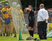 17 June 2018; Referee James Owens orders Clare players away as he speaks with his umpires during the Munster GAA Hurling Senior Championship Round 5 match between Clare and Limerick at Cusack Park in Ennis, Clare. Photo by Ray McManus/Sportsfile