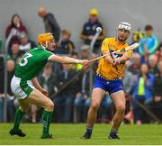 17 June 2018; Patrick O'Connor of Clare in action against Seamus Flanagan of Limerick during the Munster GAA Hurling Senior Championship Round 5 match between Clare and Limerick at Cusack Park in Ennis, Clare. Photo by Ray McManus/Sportsfile