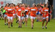 17 June 2018; The Armagh team, including Caoimhe Morgan, with her son Daire, aged 2, arrive onto the field ahead of the TG4 Ulster Ladies Football Senior Championship Final match between Armagh and Donegal at Brewster Park in Enniskillen, Co. Fermanagh. Photo by Daire Brennan/Sportsfile