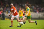 17 June 2018; Bridget Gallagher of Donegal in action against Sarah Marley of Armagh during the TG4 Ulster Ladies Football Senior Championship Final match between Armagh and Donegal at Brewster Park in Enniskillen, Co. Fermanagh. Photo by Daire Brennan/Sportsfile