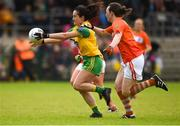 17 June 2018; Ann Marie McGlynn of Donegal in action against Tiarna Grimes of Armagh during the TG4 Ulster Ladies Football Senior Championship Final match between Armagh and Donegal at Brewster Park in Enniskillen, Co. Fermanagh. Photo by Daire Brennan/Sportsfile