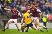 17 June 2018; Diarmuid Murtagh of Roscommon is fouled by Thomas Flynn, 9, and Eoghan Kerin of Galway which resulted in a Roscommon penalty during the Connacht GAA Football Senior Championship Final match between Roscommon and Galway at Dr Hyde Park in Roscommon. Photo by Ramsey Cardy/Sportsfile