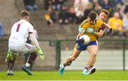 17 June 2018; Diarmuid Murtagh of Roscommon is tackled by Eoghan Kerin of Galway during the Connacht GAA Football Senior Championship Final match between Roscommon and Galway at Dr Hyde Park in Roscommon. Photo by Ramsey Cardy/Sportsfile