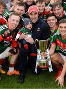 17 June 2018; Mayo manager Mike Solan with his son Teddy, 4 months old, during celebrations after the EirGrid Connacht GAA Football U20 Championship Final match between Mayo and Roscommon at Dr Hyde Park in Roscommon. Photo by Piaras Ó Mídheach/Sportsfile