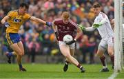 17 June 2018; Seán Andy Ó Ceallaigh of Galway, supported by team-mate Ruairí Lavelle in action against Tadhg O'Rourke of Roscommon during the Connacht GAA Football Senior Championship Final match between Roscommon and Galway at Dr Hyde Park in Roscommon. Photo by Piaras Ó Mídheach/Sportsfile