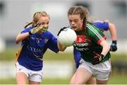17 June 2018; Milly Sherridan of Mayo in action against Nora Martin  of Tipperary during the All-Ireland Ladies Football U14 B Final between Mayo and Tipperary at Duggan Park in Ballinasloe, Co. Galway   Photo by Harry Murphy/Sportsfile