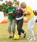 19 June 2018; Amelija Volavaite, age 9, with SNA's Ann Kelly, left, and Lisa Dowling during the visually impaired football training and match day at St Joseph's Primary School in Drumcondra, Dublin. Photo by David Fitzgerald/Sportsfile