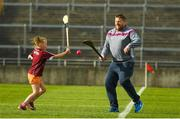 20 June 2018; Martin Keena with his daughter Holly Keena, aged eight, from Athlone, Co. Westmeath, play on the pitch prior to the Bord Gáis Energy Leinster GAA Hurling U21 Championship Semi-Final match between Kilkenny and Galway at Bord Na Mona O'Connor Park in Tullamore, Co Offaly. Photo by Harry Murphy/Sportsfile