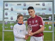 20 June 2018; Evan Niland of Galway is presented with the Bord Gáis Energy Man of the Match by Sean Fahy, aged 10, from Carnmore, Co. Galway, following the Bord Gáis Energy Leinster GAA Hurling U21 Championship Semi-Final match between Kilkenny and Galway. Bord Gáis Energy offers its customers unmissable rewards throughout the Championship season, including match tickets and hospitality, access to training camps with Hurling stars and the opportunity to present Man of the Match Awards at U-21 games. Bord Na Mona O'Connor Park, Tullamore, Co Offaly. Photo by Harry Murphy/Sportsfile