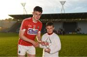 20 June 2018; Presenting Darragh Fitzgibbon of Cork with his Bord Gáis Energy Man of the Match award following the meeting of Cork and Waterford in Pairc Ui Chaoimh is Joey Middleton, age 9, from Crosshaven, Cork. Bord Gáis Energy offers its customers unmissable rewards throughout the Championship season, including match tickets and hospitality, access to training camps with Hurling stars and the opportunity to present Man of the Match Awards at U-21 games. Pairc Ui Chaoimh, Cork. Photo by Eóin Noonan/Sportsfile
