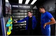 21 June 2018; The Leinster Rugby players were back for pre-season training today in UCD and new kit partner adidas were on hand to kit out the players with their new training apparel for 2018/19. The adidas boot van was also on site in UCD for players to try on the latest adidas footwear ahead of pre-season training. The new adidas Leinster Rugby training kit will be available to pre-order from Life Style Sports from this Friday, 22nd June 2018 at lifestylesports.com. Pictured is Max Deegan and Darren Byrne, Senior Key Account Manager Rugby, adidas Ireland. Photo by Ramsey Cardy/Sportsfile