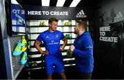 21 June 2018; The Leinster Rugby players were back for pre-season training today in UCD and new kit partner adidas were on hand to kit out the players with their new training apparel for 2018/19. The adidas boot van was also on site in UCD for players to try on the latest adidas footwear ahead of pre-season training. The new adidas Leinster Rugby training kit will be available to pre-order from Life Style Sports from this Friday, 22nd June 2018 at lifestylesports.com. Pictured is Josh van der Flier and Darren Byrne, Senior Key Account Manager Rugby, adidas Ireland. Photo by Ramsey Cardy/Sportsfile
