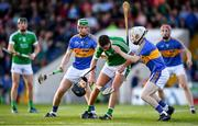 21 June 2018; Barry Murphy of Limerick is tackled by Brian McGrath, left, and Killian O'Dwyer of Tipperary during the Bord Gais Energy Munster Under 21 Hurling Championship Semi-Final match between Tipperary and Limerick at Semple Stadium in Thurles, Tipperary. Photo by Eóin Noonan/Sportsfile