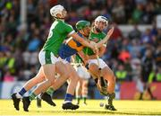21 June 2018; Paudie Feehan of Tipperary is tackled by Kyle Hayes, left, and Wille O'Meara of Limerick during the Bord Gais Energy Munster Under 21 Hurling Championship Semi-Final match between Tipperary and Limerick at Semple Stadium in Thurles, Tipperary. Photo by Eóin Noonan/Sportsfile