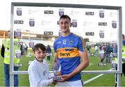 21 June 2018; Presenting Mark Kehoe of Tipperary with his Bord Gáis Energy Man of the Match award following the meeting of Tipperary and Limerick in Semple Stadium is Jake Grace, age 9, from Ballybrown, Limerick. Bord Gáis Energy offers its customers unmissable rewards throughout the Championship season, including match tickets and hospitality, access to training camps with Hurling stars and the opportunity to present Man of the Match Awards at U-21 games. Photo by Eóin Noonan/Sportsfile