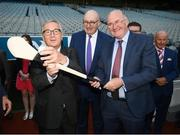 22 June 2018; President of the European Commission Jean-Claude Juncker receives a gift of a Hurley from Uachtarán Chumann Lúthchleas Gael John Horan, right, in the company of European Commissioner for Agriculture Phil Hogan, centre, during a visit to Croke Park in Dublin. Photo by Stephen McCarthy/Sportsfile
