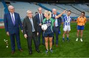 22 June 2018; Stacey Cahill, Na Fianna Ladies, Kildare, demonstrates gaelic football to President of the European Commission Jean-Claude Juncker in the company of European Commissioner for Agriculture Phil Hogan, left, Tánaiste Simon Coveney and Uachtarán Chumann Lúthchleas Gael John Horan, right, during a visit to Croke Park in Dublin. Photo by Stephen McCarthy/Sportsfile