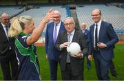 22 June 2018; Stacey Cahill, Na Fianna Ladies, Kildare, demonstrates gaelic football to President of the European Commission Jean-Claude Juncker in the company of European Commissioner for Agriculture Phil Hogan and  Tánaiste Simon Coveney, right, during a visit to Croke Park in Dublin. Photo by Stephen McCarthy/Sportsfile