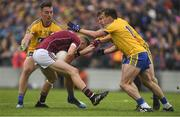17 June 2018; Johnny Heaney of Galway in action against Roscommon players, from left, John McManus, Niall Kilroy and Conor Devaney during the Connacht GAA Football Senior Championship Final match between Roscommon and Galway at Dr Hyde Park in Roscommon. Photo by Piaras Ó Mídheach/Sportsfile
