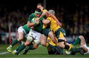 23 June 2018; CJ Stander of Ireland is tackled by Dane Haylett-Petty, left, and Nick Phipps of Australia during the 2018 Mitsubishi Estate Ireland Series 3rd Test match between Australia and Ireland at Allianz Stadium in Sydney, Australia. Photo by Brendan Moran/Sportsfile