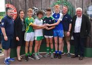 23 June 2018; Joint first place players in the Boys Football competition, from left, Sean Doyle of St Nicholas GAA Club, Co. Wicklow, Eoin Loughran of St. Mary's Burren GAA Club, Co. Down, Paddy Kennedy of Galbally GAA Club, Co. Limerick, and Michael McSweeney of Knocknagree GAA Club, Co. Cork, are pictured with, from left, John Cunningham, National Féile Committee, Anne-Claire Monde, John West Marketing Manager, Tom Keane, National Féile Committee, and Chairman of Féile Brendan Brien, at the John West Skills Day in the National Sports Campus on Saturday 23rd June. The Skills Day is an opportunity for Ireland's rising football, hurling & camogie stars to show their skills as part of the John West Féile na nÓg and John West Féile na nGael competitions. At the National Sports Campus in Blanchardstown, Dublin. Photo by Seb Daly/Sportsfile