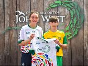 23 June 2018; Peter Kelly from St Eunans GAA Club in Co. Dinegal pictured with Dublin Camogie player Eve O'Brien at the John West Skills Day in the National Sports Campus on Saturday 23rd June. The Skills Day is an opportunity for Ireland's rising football, hurling & camogie stars to show their skills as part of the John West Féile na nÓg and John West Féile na nGael competitions. At the National Sports Campus in Blanchardstown, Dublin. Photo by Seb Daly/Sportsfile