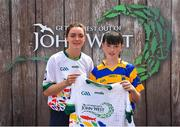 23 June 2018; Jack McGrath from Abbeyside GAA Club in Co. Waterford pictured with Dublin Camogie player Eve O'Brien at the John West Skills Day in the National Sports Campus on Saturday 23rd June. The Skills Day is an opportunity for Ireland's rising football, hurling & camogie stars to show their skills as part of the John West Féile na nÓg and John West Féile na nGael competitions. At the National Sports Campus in Blanchardstown, Dublin. Photo by Seb Daly/Sportsfile