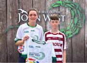23 June 2018; Ruairi O Mainan from Slaughtneil GAA Club in Co. Derry pictured with Dublin Camogie player Eve O'Brien at the John West Skills Day in the National Sports Campus on Saturday 23rd June. The Skills Day is an opportunity for Ireland's rising football, hurling & camogie stars to show their skills as part of the John West Féile na nÓg and John West Féile na nGael competitions. At the National Sports Campus in Blanchardstown, Dublin. Photo by Seb Daly/Sportsfile