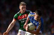23 June 2018; Michael Quinlivan of Tipperary in action against Paddy Durcan of Mayo during the GAA Football All-Ireland Senior Championship Round 2 match between Tipperary and Mayo at Semple Stadium in Thurles, Tipperary. Photo by Ray McManus/Sportsfile