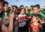 23 June 2018; Lee Keegan of Mayo poses for a photo with a Mayo supporter after the GAA Football All-Ireland Senior Championship Round 2 match between Tipperary and Mayo at Semple Stadium in Thurles, Tipperary. Photo by Ray McManus/Sportsfile