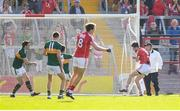 23 June 2018; Jamie O'Sullivan of Cork collides with the post after scoring his side's first goal during the Munster GAA Football Senior Championship Final match between Cork and Kerry at Páirc Ui Chaoimh in Cork. Photo by Stephen McCarthy/Sportsfile