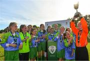 23 June 2018; Addison Emma Daughtry of Metropolitan Girls League lifts the trophy after the U12's Finals match between Metropolitan Girls League and Sligo/Leitrim League on the Saturday of the Fota Island Resort Gaynor Tournament at the University of Limerick in Limerick. Photo by Harry Murphy/Sportsfile