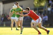 23 June 2018; Paddy Maguire of Leitrim is tackled by Tommy Durnin of Louth during the GAA Football All-Ireland Senior Championship Round 2 match between Leitrim and Louth at Páirc Seán Mac Diarmada in Carrick-on-Shannon, Co. Leitrim. Photo by Ramsey Cardy/Sportsfile