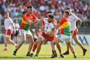 23 June 2018; Ronan McNamee of Tyrone in action against Eoghan Ruth, Shane Redmond and Jordan Morrissey of Carlow during the GAA Football All-Ireland Senior Championship Round 2 match between Carlow and Tyrone at Netwatch Cullen Park in Carlow. Photo by Matt Browne/Sportsfile