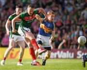 23 June 2018; Andy Moran of Mayo fires a shot at goal despite the attention of  Brian Fox of Tipperary during the GAA Football All-Ireland Senior Championship Round 2 match between Tipperary and Mayo at Semple Stadium in Thurles, Tipperary. Photo by Ray McManus/Sportsfile