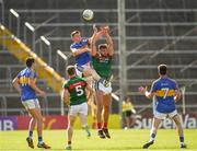 23 June 2018; John Meagher of Tipperary and Aidan O'Shea of Mayo jump highest in an effort to win possession during the GAA Football All-Ireland Senior Championship Round 2 match between Tipperary and Mayo at Semple Stadium in Thurles, Tipperary. Photo by Ray McManus/Sportsfile