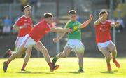 23 June 2018; Darragh Rooney of Leitrim has a shot blocked by Darren Marks, left, and Derek Maguire of Louth during the GAA Football All-Ireland Senior Championship Round 2 match between Leitrim and Louth at Páirc Seán Mac Diarmada in Carrick-on-Shannon, Co. Leitrim. Photo by Ramsey Cardy/Sportsfile