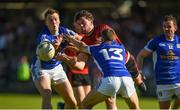 23 June 2018; Niall Madine of Down in action against Niall Murray, left, and Conor Bradley of Cavan during the GAA Football All-Ireland Senior Championship Round 2 match between Cavan and Down at Brewster Park in Enniskillen, Co. Fermanagh. Photo by Barry Cregg/Sportsfile