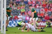 23 June 2018; Paul Geaney of Kerry scoring his side's third goal despite the efforts of Mark White of Cork during the Munster GAA Football Senior Championship Final match between Cork and Kerry at Páirc Ui Chaoimh in Cork. Photo by Eóin Noonan/Sportsfile