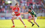 23 June 2018; Paul Kerrigan of Cork and Kevin McCarthy of Kerry during the Munster GAA Football Senior Championship Final match between Cork and Kerry at Páirc Ui Chaoimh in Cork. Photo by Stephen McCarthy/Sportsfile