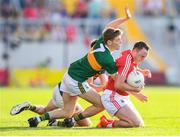 23 June 2018; Paul Kerrigan of Cork is tackled by Gavin White of Kerry during the Munster GAA Football Senior Championship Final match between Cork and Kerry at Páirc Ui Chaoimh in Cork. Photo by Stephen McCarthy/Sportsfile