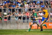 24 June 2018; Pearse Lillis of Clare shoots under pressure from Niall Darby of Offaly during the GAA Football All-Ireland Senior Championship Round 2 match between Offaly and Clare at Bord Na Mona O'Connor Park in Tullamore, Offaly. Photo by Harry Murphy/Sportsfile