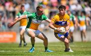 24 June 2018; Keelan Sexton of Clare in action against Declan Hogan of Offaly during the GAA Football All-Ireland Senior Championship Round 2 match between Offaly and Clare at Bord Na Mona O'Connor Park in Tullamore, Offaly. Photo by Harry Murphy/Sportsfile